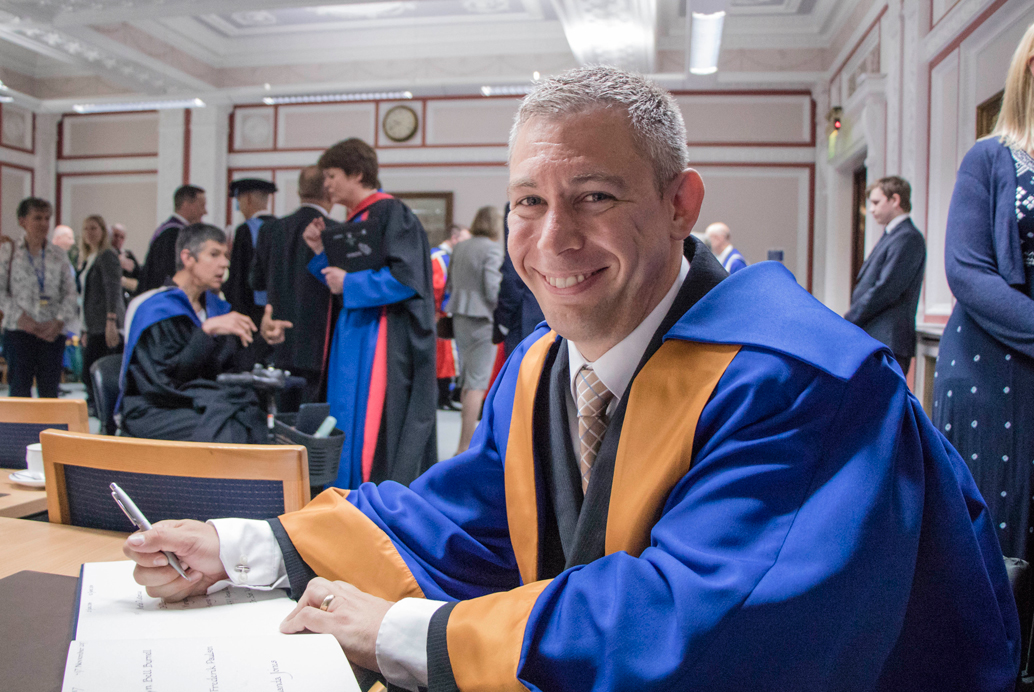 Photo of Dr Pistorius smiling, at the Bonar Hall event.