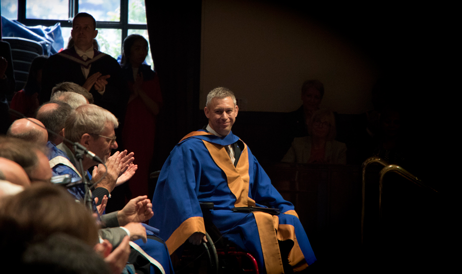 Photo of Martin Pistorius receiving honorary award