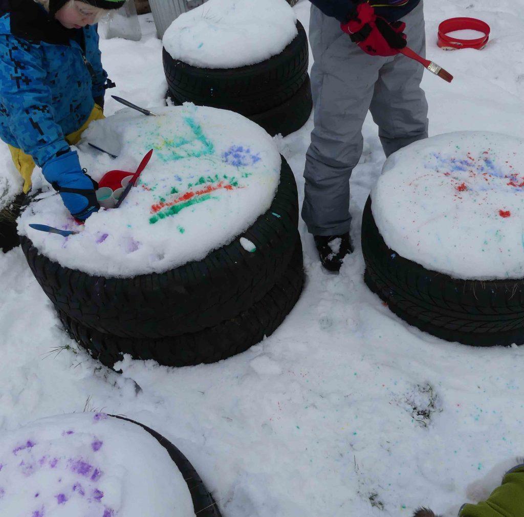 splatting paint into snow