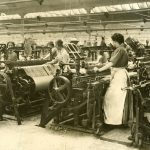 Image of women and machinery weaving inside Baxter Bros factory