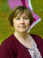 picture of Doctor Heidi Lomell in front of colourful wall.