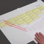 A large sheet of paper with completed tesk on is being copied by statement number to a smaller A4 sheet by researcher