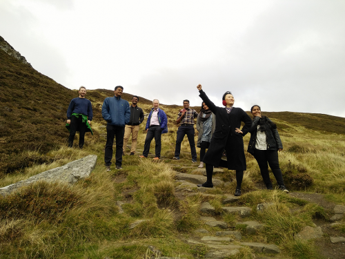 GoDARTS 20th Anniversary-Post Doc Yu Huang strikes a pose half way up Ben Vrackie