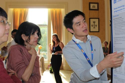 GoDARTS-Pitlochry-Posters-Ryan Kwan UoD discussing his poster with Dr Kathy Giacomini